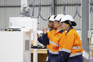 Staff members working in Clever Core factory